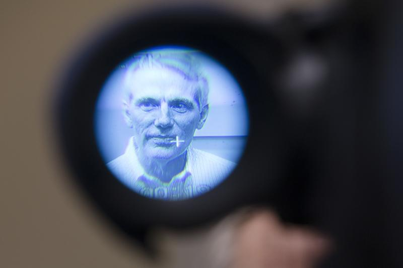U.S. Sen. Rob Portman, R-Ohio, is seen through a television camera after an event to discuss efforts to increase health and safety for workers. April 1, 2016