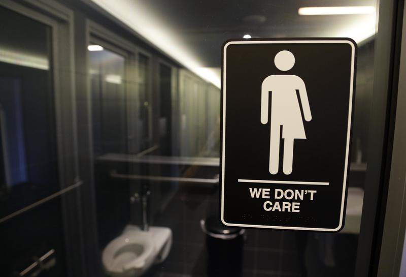 In this photo taken Thursday, May 12, 2016, signage is seen outside a restroom at 21c Museum Hotel in Durham, N.C.
