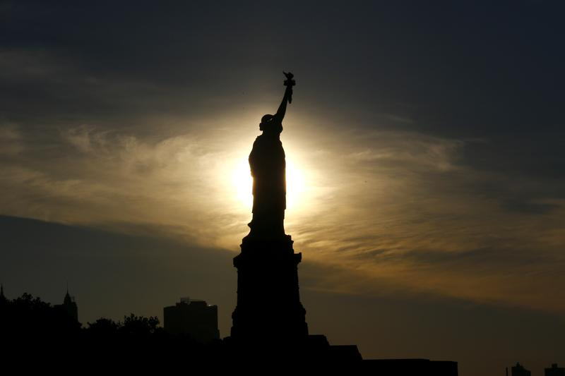 The sun rises behind the Statue of Liberty a day before the United States celebrates its independence, Sunday, July 3, 2016, in Jersey City, N.J.
