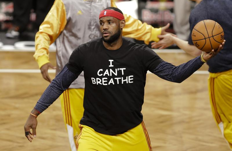 "In this Dec. 8, 2014 file photo, Cleveland Cavaliers' LeBron James wears a T-shirt reading ""I Can't Breathe,"" during warms up before an NBA basketball game against the Brooklyn Nets in New York."