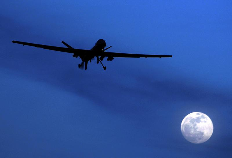 Jan. 31, 2010: An unmanned U.S. Predator drone flies over Kandahar Air Field, southern Afghanistan, on a moon-lit night.