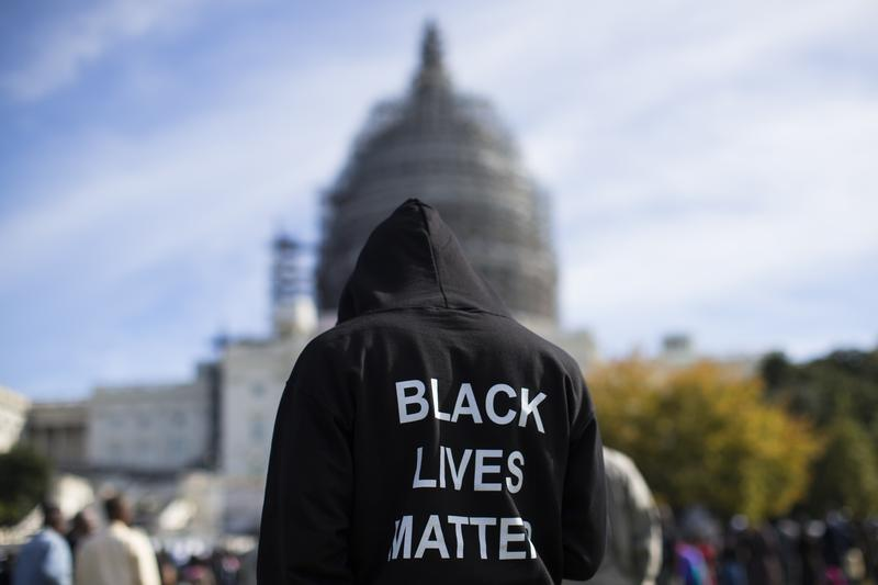 Oct. 20, 2015: A man stands on the lawn of the Capitol building on Capitol Hill in Washington during a rally to mark the 20th anniversary of the Million Man March
