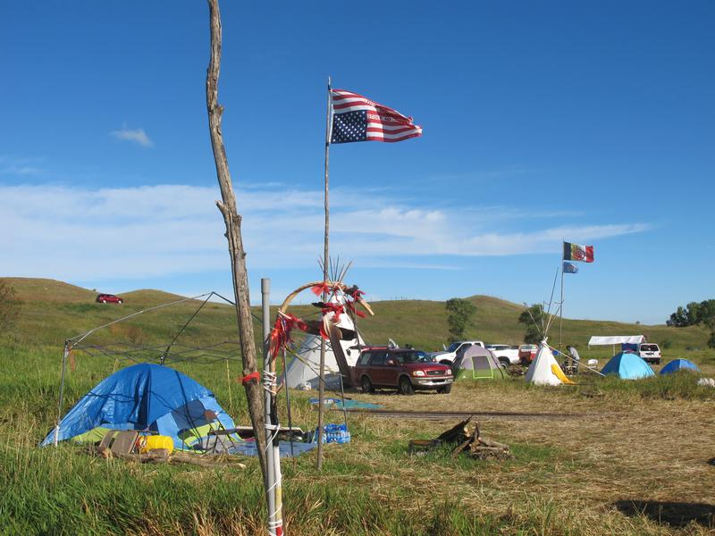 An American flag flies upside down in protest at an encampment near North Dakota's Standing Rock Sioux reservation on Friday, Sept. 9, 2016.