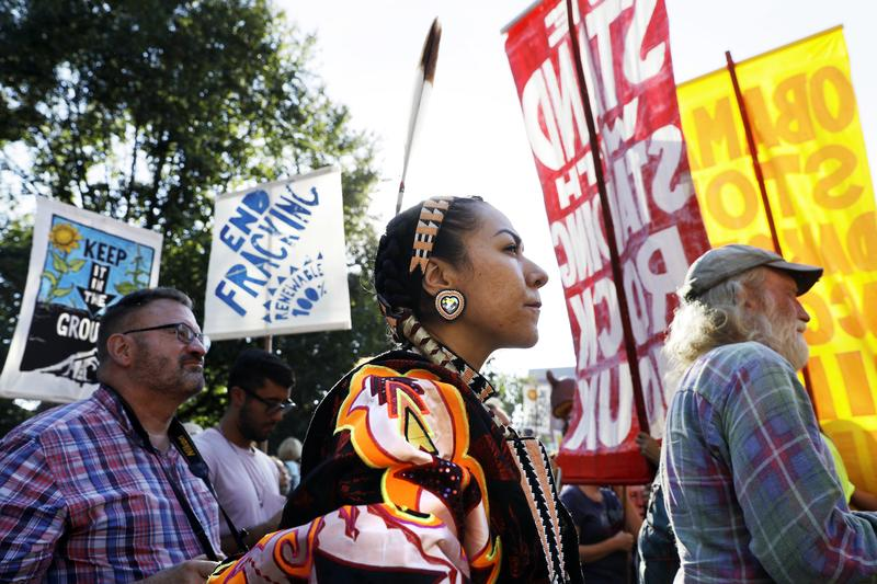 Angela Miracle Gladue, center, a member of the Frog Lake First Nations, a Cree community in Edmonton, Alberta, Canada, attends a rally in support of the Standing Rock Sioux Tribe.