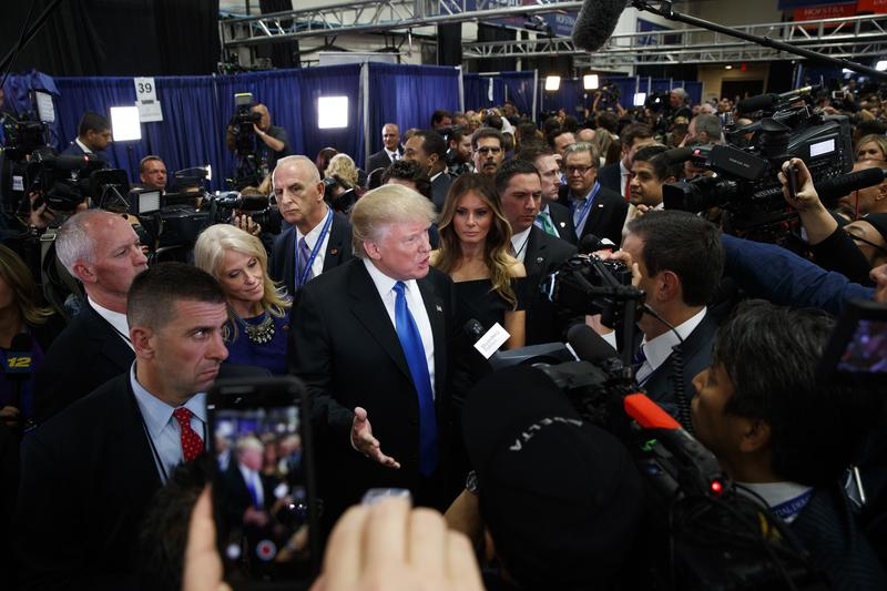 Republican presidential candidate Donald Trump speaks with reporters in the spin room after the first presidential debate against Democratic presidential candidate Hillary Clinton. Sep 26, 2016.