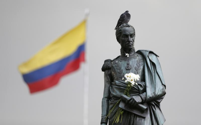 Flowers decorate the statue of independence hero Simon Bolivar at the main square in downtown Bogota, Colombia, Friday, Oct. 7, 2016.
