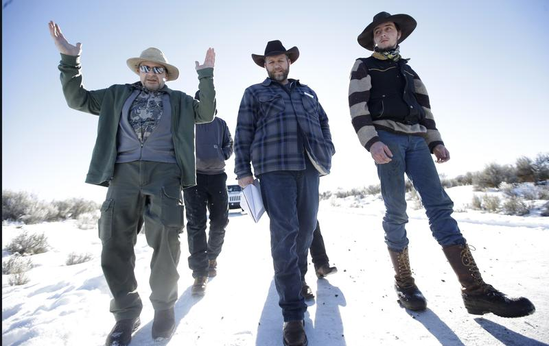 Jan 8, 2016: Burns resident Steve Atkins, left, talks with Ammon Bundy, center, one of the sons of Nevada rancher Cliven Bundy, following a news conference at Malheur National Wildlife Refuge.