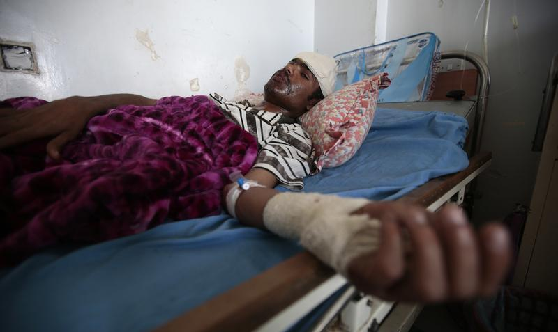 A man lies in a hospital bed after he was injured in Saudi-led airstrikes targeting a funeral hall, in Sanaa, Yemen, Monday, Oct. 10, 2016.