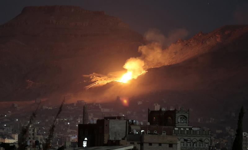 Fire and smoke rise after a Saudi-led airstrike hit a site believed to be one of the largest weapons depots on the outskirts of Yemen's capital, Sanaa, Friday, Oct. 14, 2016.