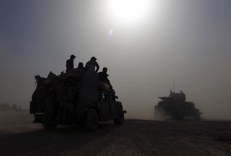 Iraq's elite counterterrorism forces gather ahead of an operation to re-take the Islamic State-held City of Mosul, outside Irbil, Iraq, Saturday, Oct. 15, 2016.