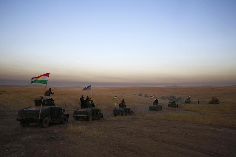 A Peshmerga convoy drives towards a frontline in Khazer, about 30 kilometers (19 miles) east of Mosul, Iraq, Monday, Oct. 17, 2016.