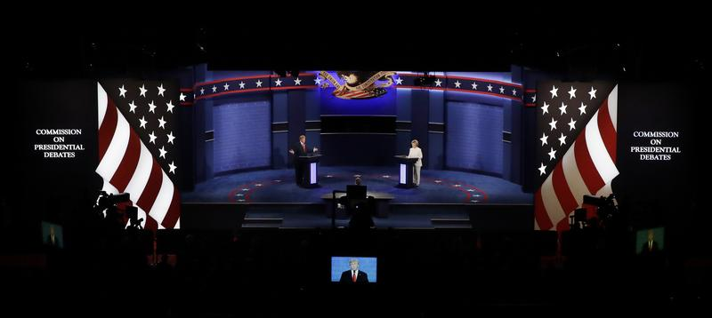 Democratic presidential nominee Hillary Clinton and Republican presidential nominee Donald Trump debate during the third presidential debate at UNLV in Las Vegas, Wednesday, Oct. 19, 2016.