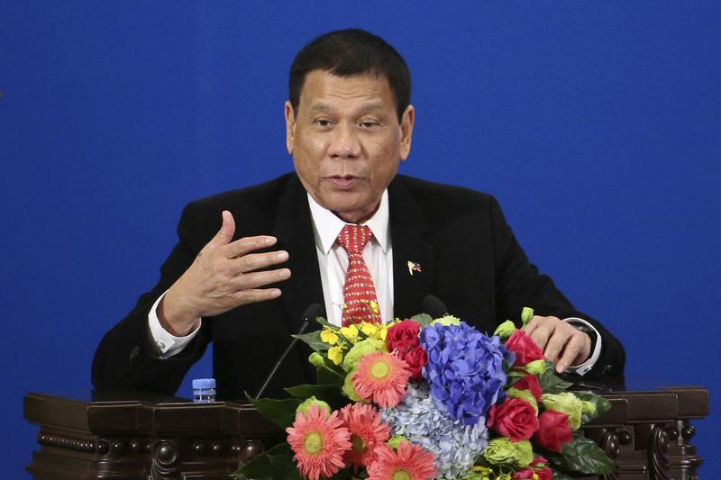 Philippine President Rodrigo Duterte delivers a speech during the Philippines-China Trade and Investment Forum at the Great Hall of the People in Beijing Thursday, Oct. 20, 2016.