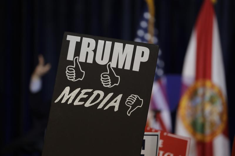 Campaign signs before a speech by Republican presidential candidate Donald Trump Saturday, Nov. 5, 2016, in Tampa, Fla.