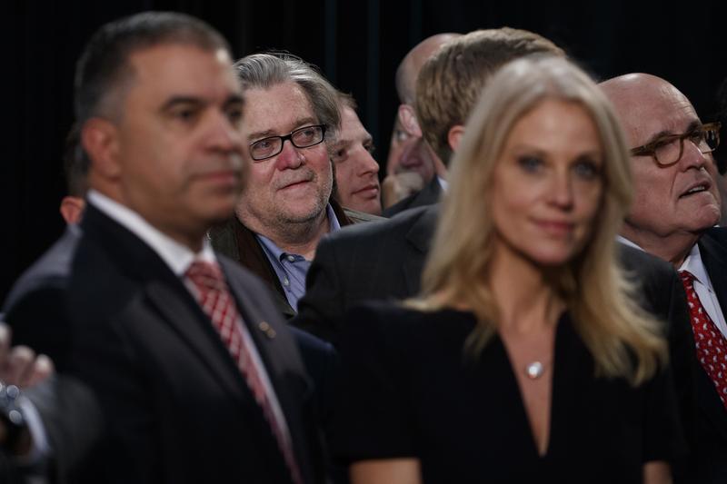Steve Bannon, center left, back, stands among Trump cabinet hopeful, Rudy Giuliani, right, back.