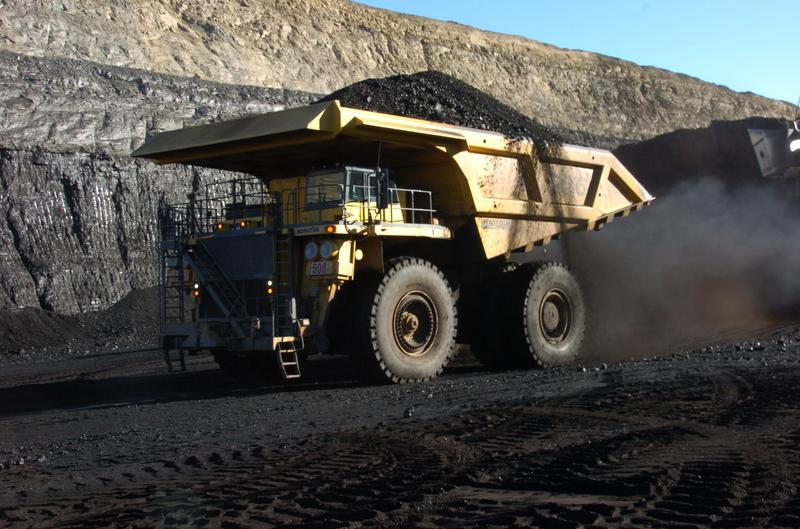 In this Nov. 15, 2016 photo, a haul truck with a 250-ton capacity carries coal from the Spring Creek strip mine near Decker, Mont.