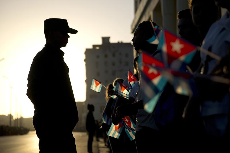 Nov. 30, 2016: A soldier is silhouetted against the early morning sky as residents with Cuban flags wait for the funeral procession carrying the remains of the late Fidel Castro in Havana, Cuba.