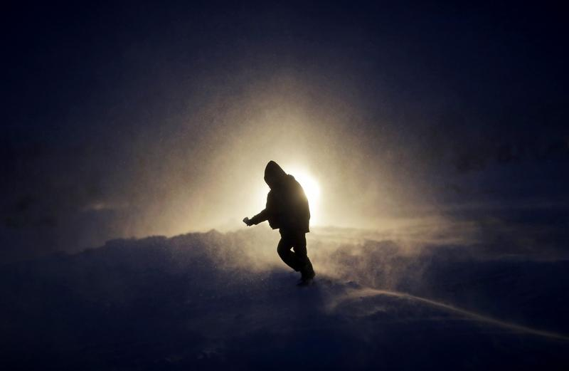 Nov. 29, 2016: A person walks through a snow storm at the Oceti Sakowin camp where people have gathered to protest the Dakota Access oil pipeline in Cannon Ball, N.D.