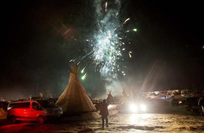 Fireworks go off over the Oceti Sakowin camp where people have gathered to protest the Dakota Access oil pipeline in Cannon Ball, N.D., Sunday, Dec. 4, 2016.