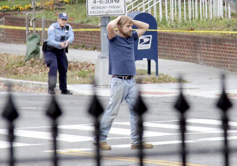Edgar Maddison Welch, 28 of Salisbury, N.C., surrenders to police Sunday, Dec. 4, 2016, in Washington.