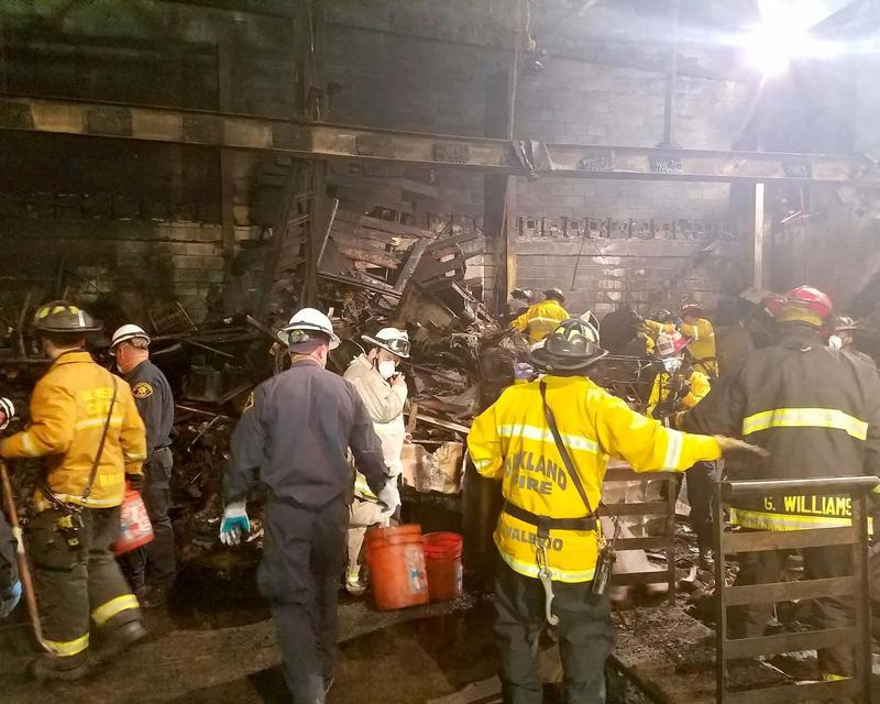 This photo provided by the City of Oakland shows inside the burned warehouse after the deadly fire that broke out on Dec. 2, 2016, in Oakland, Calif.
