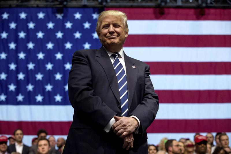 In this Dec. 9, 2016, photo, President-elect Donald Trump smiles during a rally at DeltaPlex Arena in Grand Rapids, Mich.