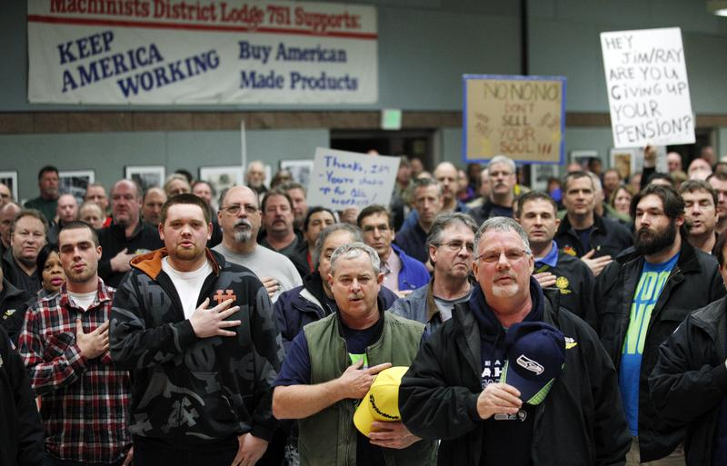 Machinists union members and supporters hold their right hands over their hearts as they recite the Pledge of Allegiance to begin a rally asking members to vote against a proposed contract. 01/02/14