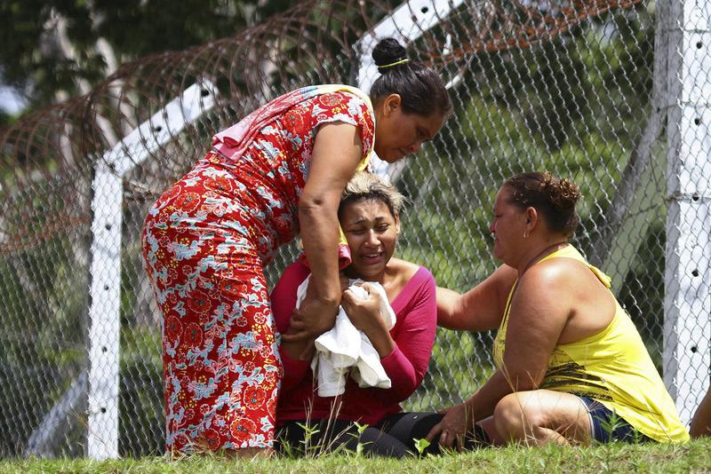 The wife of a prisoner who was killed in a riot cries outside Anisio Jobim Penitentiary Complex in Manaus, Brazil, Monday, Jan. 2, 2017.
