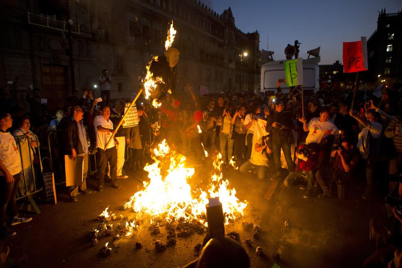 Protestors burned representations of Donald Trump and Enrique Pena Nieto during a march by thousands angry at the government following a 20 percent rise in gas prices. Jan. 9, 2017