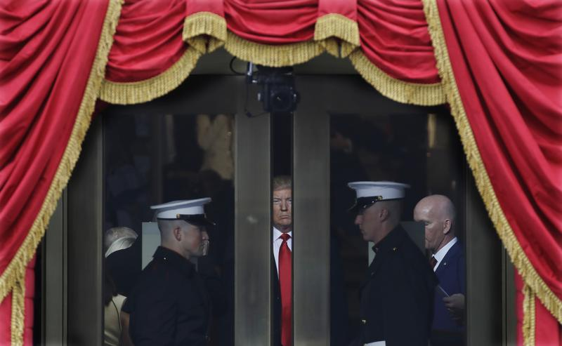 President-elect Donald Trump waits to step out onto the portico for his Presidential Inauguration at the U.S. Capitol in Washington, Friday, Jan. 20, 2017.
