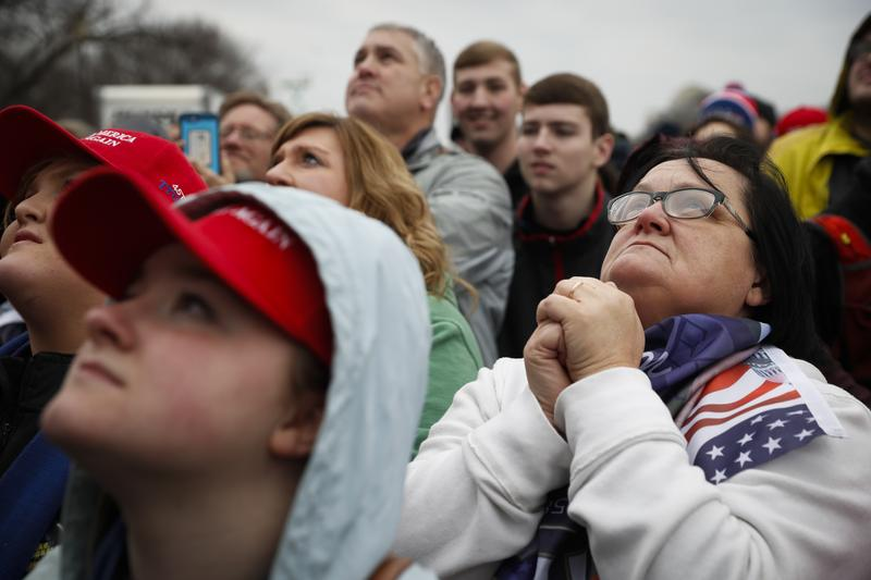 Supporters react as President-elect Donald Trump appears for his inauguration, Friday, Jan. 20, 2017, in Washington.