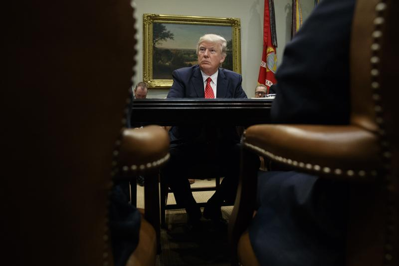 President Donald Trump listens during a meeting with county sheriffs in the Roosevelt Room of the White House in Washington, Tuesday, Feb. 7, 2017.