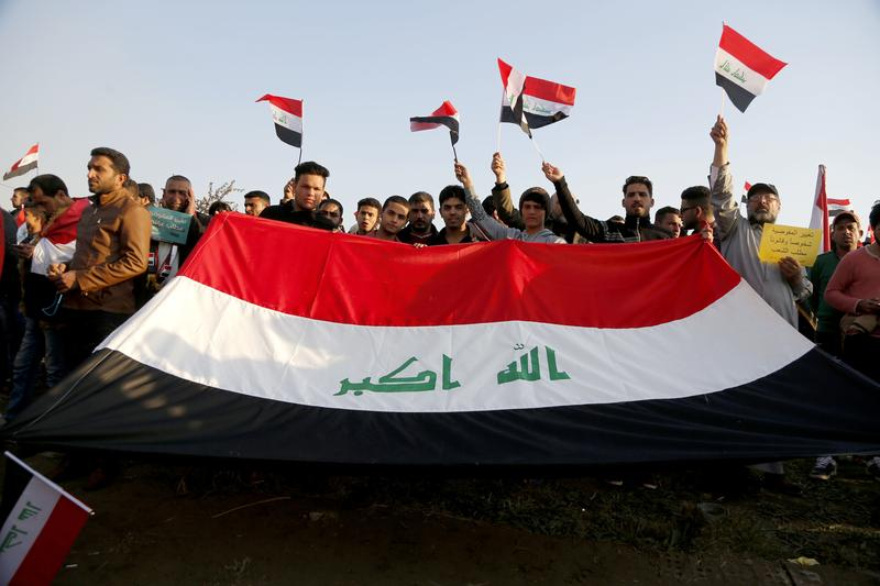 Followers of Iraq's influential Shiite cleric Muqtada al-Sadr chant slogans demanding government reform as they wave national flags during a demonstration in Baghdad, Iraq, Wednesday, Feb. 8, 2017.