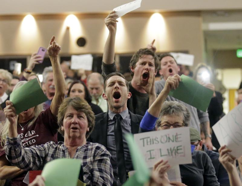 People shout to Rep. Jason Chaffetz during his town hall meeting at Brighton High School Thursday, Feb. 9, 2017, in Cottonwood Heights, Utah.