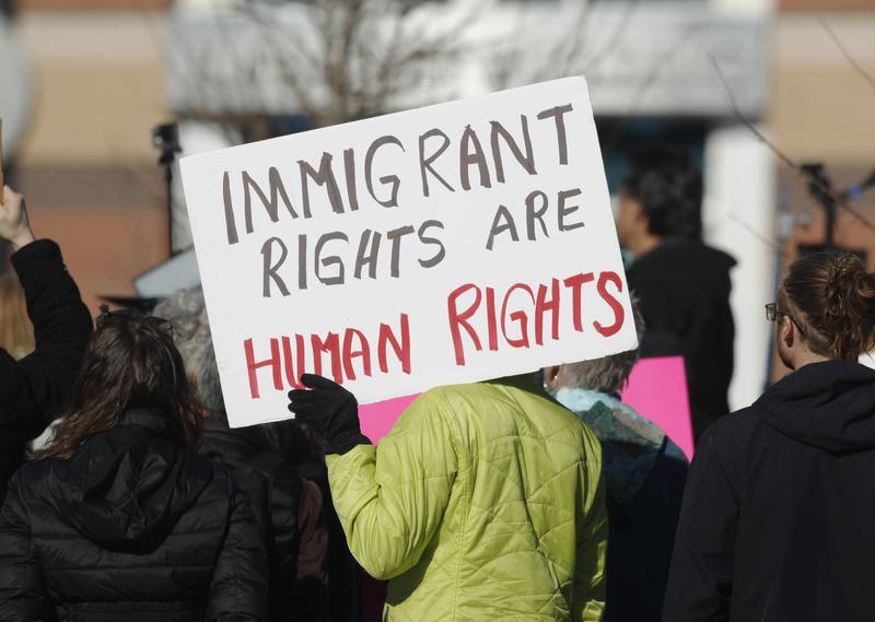 A supporter holds up a placard during a rally for Jeanette Vizguerra, a Mexican woman seeking to avoid deportation from the United States. Feb. 15, 2017, in Centennial, Colo.