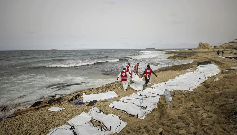 Feb. 20, 2017: Libyan Red Crescent workers recovering bodies of people that washed ashore, near Zawiya, Libya.
