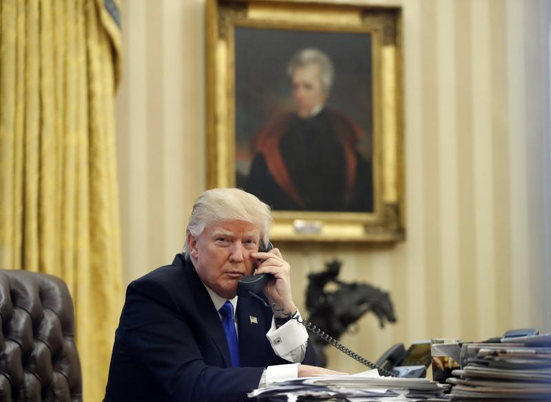 President Donald Trump in the Oval Office, Jan. 28, 2017. In the background is a portrait of former President Andrew Jackson, which Trump had installed in the first few days of his administration.