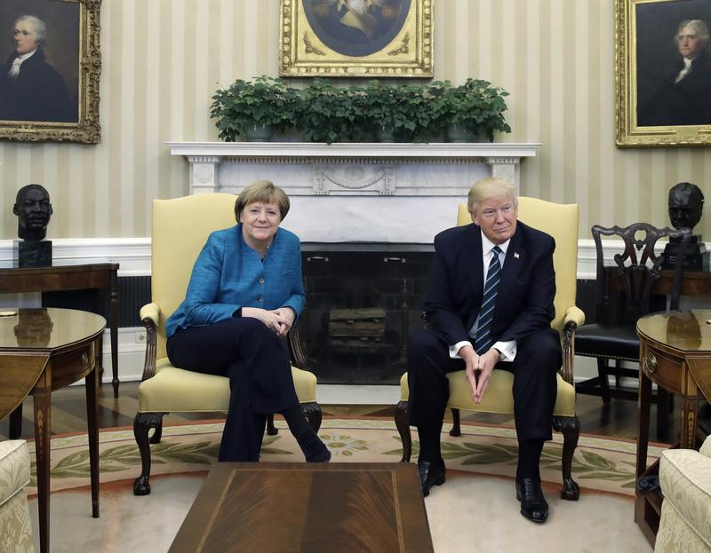 President Donald Trump and German Chancellor Angela Merkel meet in the Oval Office of the White House in Washington, Friday, March 17, 2017.