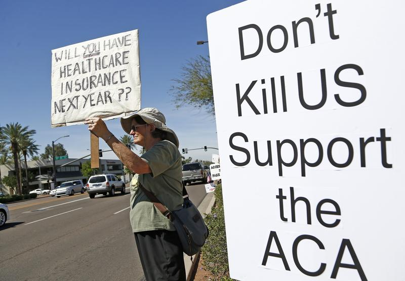 "Activists picket out in front of the offices of Republican Arizona Sen. Jeff Flake for a ""Stakeouts to Save Our Health Care"" to reject the new Republican proposal on healthcare. 3/17/17"