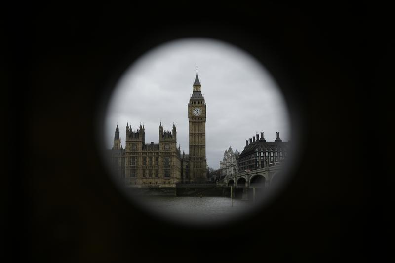 "The Houses of Parliament and Elizabeth Tower containing the bell know as ""Big Ben"" are framed by a hole in a stand that used to house a telescope for tourists to use in London, Monday, March 20, 2017."