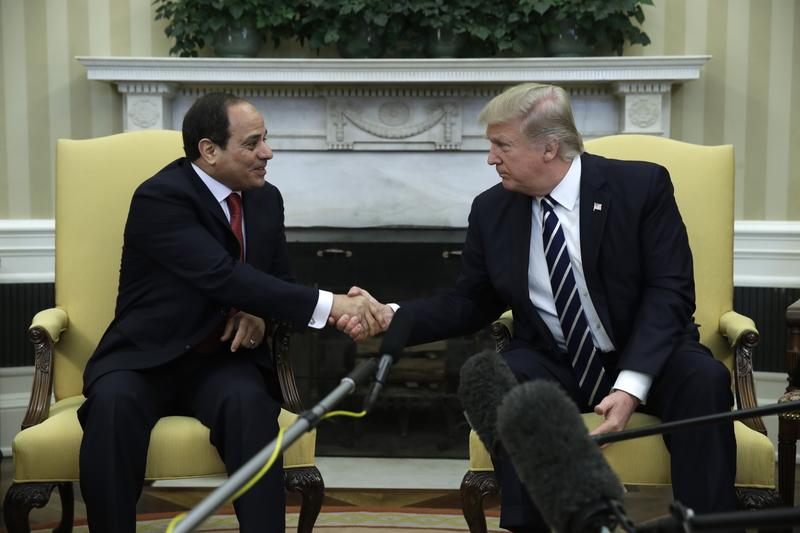 President Donald Trump shakes hands with Egyptian President Abdel Fattah al-Sisi in the Oval Office of the White House in Washington, Monday, April, 3, 2017.