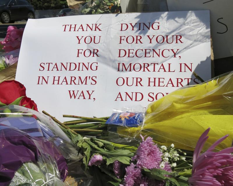 A sign of thanks at a memorial outside the transit center in Portland, Ore. on Saturday, May 27, 2017 after two people were fatally stabbed for standing against an anti-Muslim attack.