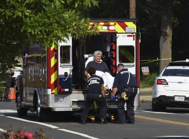 Rep. Roger Williams, R-Texas is placed into an ambulance at the scene of a shooting at a baseball field in Alexandria, Va., Wednesday, June 14, 2017.