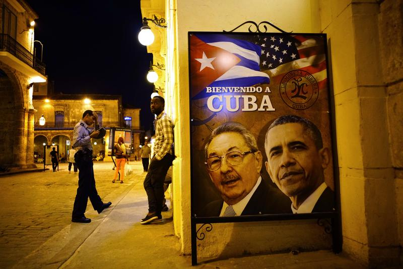 "A poster features portraits of Cuba's President Raul Castro, left, and U.S. President Barack Obama and reads in Spanish ""Welcome to Cuba"" outside a restaurant in Havana, Cuba, Thursday, March 17, 2016"