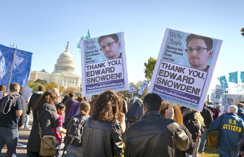 Demonstrators rally at the U.S. Capitol to protest spying on Americans by the National Security Agency, as revealed in leaked information by former NSA contractor Edward Snowden. Oct. 26, 2013