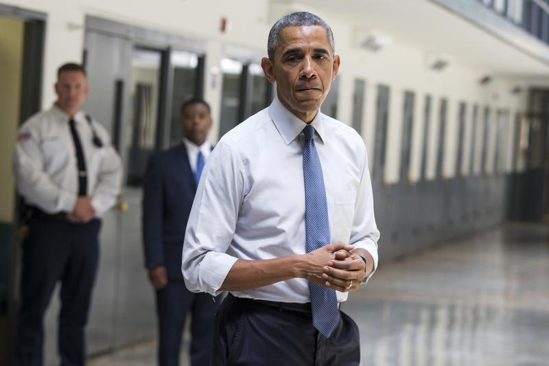 President Barack Obama pauses as he speaks at the El Reno Federal Correctional Institution in El Reno, Okla., Thursday, July 16, 2015.