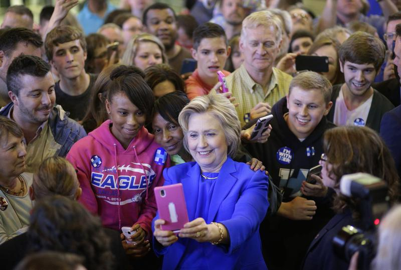 Democratic presidential candidate Hillary Clinton takes a selfie with a supporter after a speaking at a rally at Louisville Slugger Field's Hall of Fame Pavilion in Louisville, Ky., May 10, 2016.