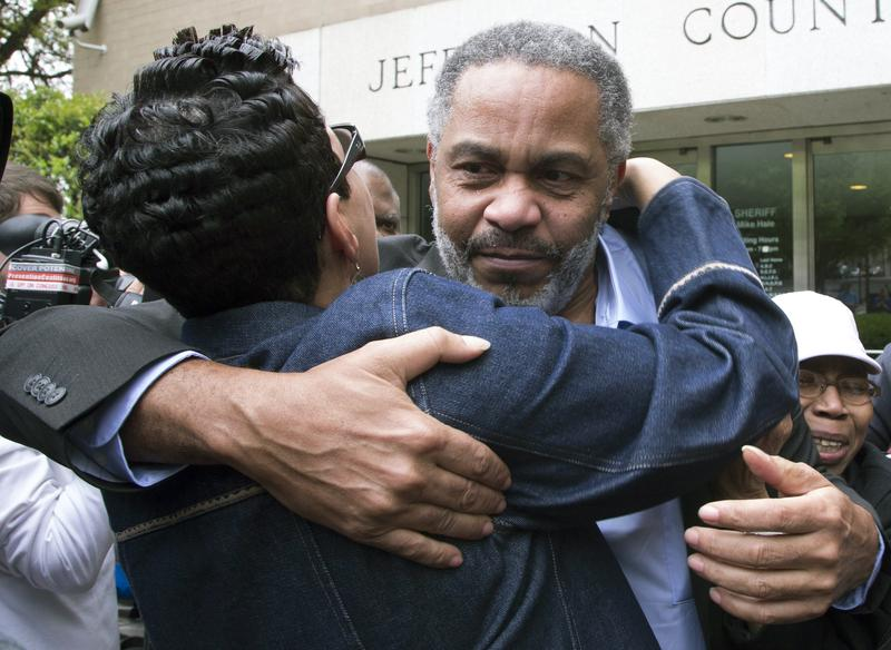 In this April 3, 2015 file photo, Pat Turner, left, hugs Anthony Ray Hinton as he leaves the Jefferson County jail in Birmingham, Ala.