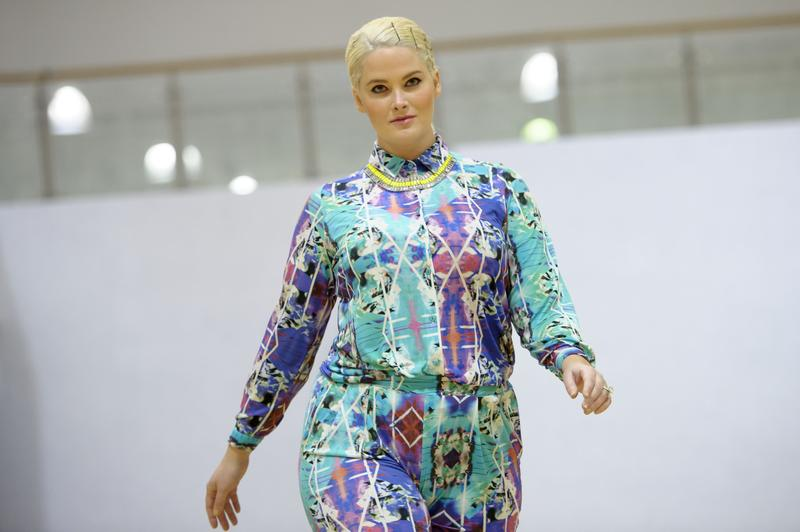 Model Whitney Thompson wears a design during the Plus Size Fashion event during London Fashion Week Autumn/Winter 2014, at Vinopolis in central London, Friday, Feb. 14, 2014.