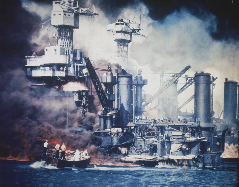 A small boat rescues a USS West Virginia crew member from the water after the Japanese bombing of Pearl Harbor, Hawaii on Dec. 7, 1941 during World War II.